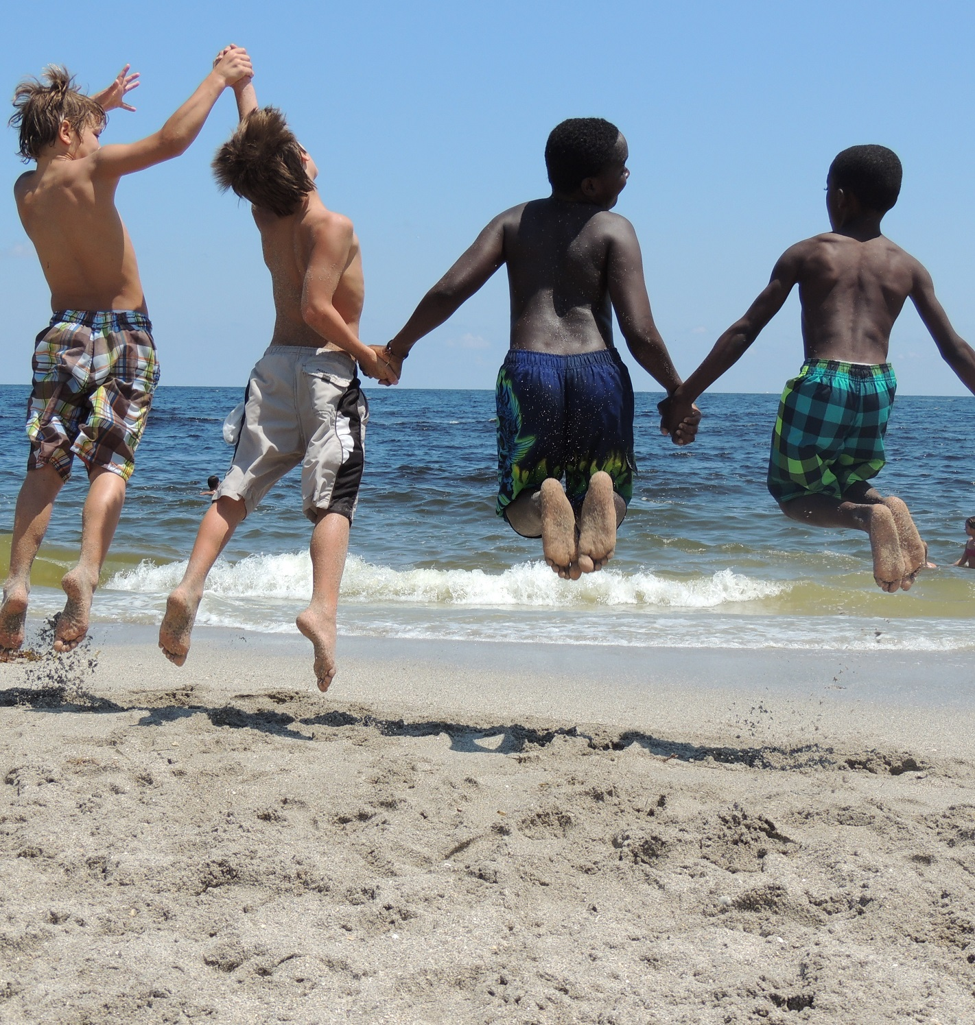 kids boys jumping beach